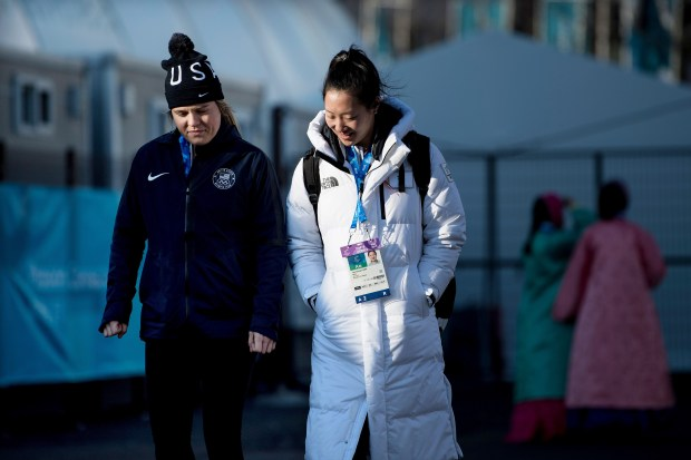 Hannah Brandt, who plays ice hockey for the United States, walks with her sister Marissa Brandt, who plays ice hockey for the Unified Korea, at the Gangneung Olympic Village before the PyeongChang 2018 Winter Olympic Games on February 6, 2018 in Gangneung, South Korea. (BRENDAN SMIALOWSKI/AFP/Getty Images)