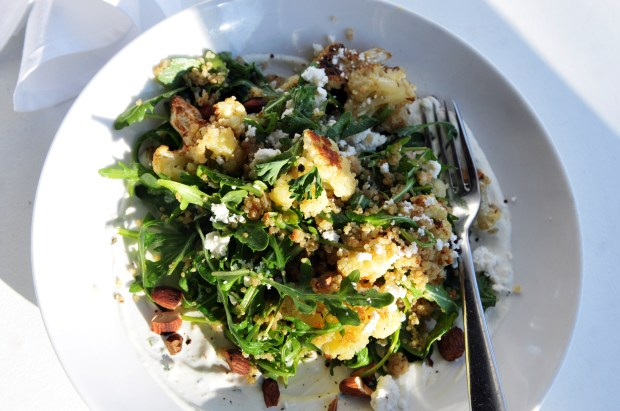 The Quinoa Bowl for $9 with cauliflower, quinoa, argula, almonds, feta, creamy sals verde and lemon vinagrette at Salty Tart in the old Heartland building at 589 E. 5th Street in St. Paul. The restaurant is open for breakfast and lunch every day is run by Michelle Gayer, owner and chef. (Ginger Pinson / Pioneer Press)