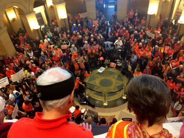 Blaze orange-clad gun control demonstrators rally Thursday, Feb. 22, 2018, in the State Capitol rotunda in St. Paul. A traditional safety color of hunters, blaze orange is also the adopted color of many gun control advocates. (Dave Orrick / Pioneer Press)