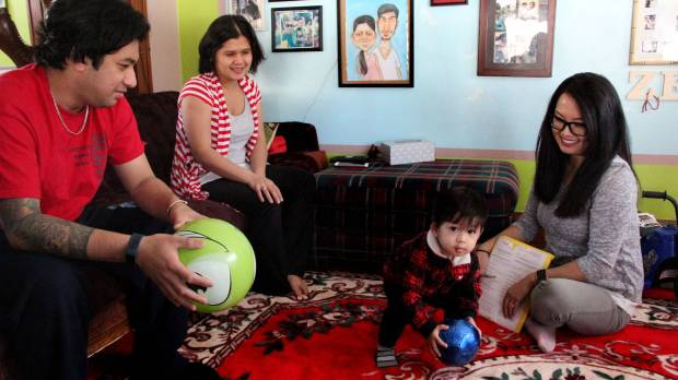 Parents KP, left, and Zipora Niowong talk with nurse Michelle Thao about their 19-month-old son Zeph at their St. Paul home on Feb. 16, 2018. The family participates in Ramsey County's Healthy Families initiative, which provides home visits from a nurse to ensure Zeph is developing properly. (Christopher Magan / Pioneer Press)