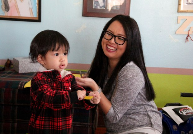Nurse Michelle Thao interacts with Zeph, 19 months, at his home in St. Paul on Feb. 16, 2018. Zeph's parents, KP and Zipora Noiwong participate in Ramsey County's Healthy Families initiative, which provides home visits from a nurse to ensure proper child development. (Christopher Magan/ Pioneer Press)