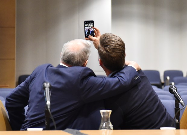 Gov. Mark Dayton, left, and House Speaker Kurt Daudt take a 'selfie' before the start of a question and answer session on the upcoming Legislative session at the Minnesota State Senate Building on Tuesday, Feb, 13, 2018. The event also featured Senate Majority Leader Paul Gazelka, House Minority Leader Melissa Hortman and Senate Minority Leader Tom Bakk. (John Autey / Pioneer Press)