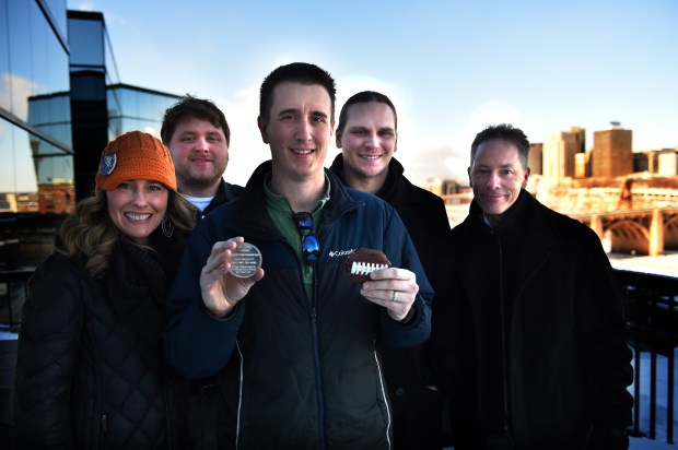 Rob Brass, center, holds the medallion he found for the Pioneer Press Treasure Hunt Thursday, Feb. 1, 2018. The teammates he searched with are from left, Stacey King, Matt Koskie, Steven Sanftner and Steve Worthman. The medallion was found Wednesday night by the three-time winner. (Jean Pieri / Pioneer Press)