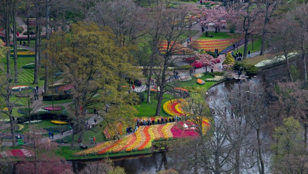 Tourists visit Keukenhof spring garden in Lisse, some 20 kilometers from Amsterdam, Netherlands. (AP Photo/Peter Dejong, File)