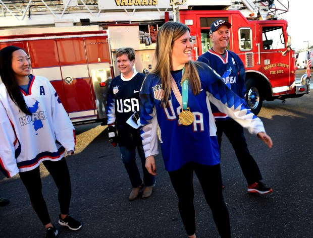 Marissa and Hannah Brandt, with their parents, Greg and Robin, walk into a welcome home celebration in Vadnais Heights on Thursday, March 8, 2018. The girls each arrived on a fire truck. The Olympian sisters represented two different countries, with Marissa competing with the Korean Women's Hockey Team and Hannah on the U.S. Women's Hockey Team at the PyeoneChang 2018 Olympic games. (Jean Pieri / Pioneer Press)