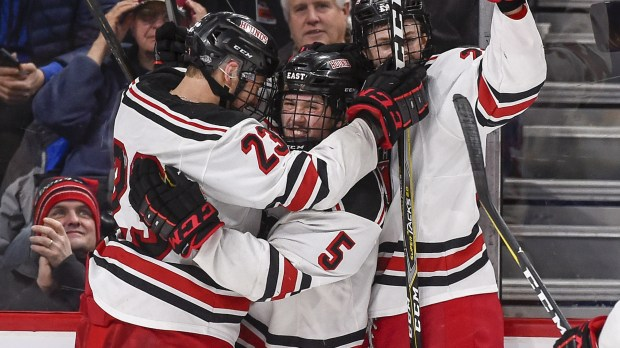 Duluth East forward Garrett Worth (5) celebrates with Duluth East Ian Mageau, left, and forward Carson Cochran, right, after scoring his third goal during second period of the the Class 2A tournament quarterfinal at Xcel Center Thursday, March 8, 2018. (Photo/Craig Lassig)