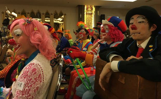 Clowns from Malaysia and Japan waiting for make-up and costume competition in Thailand last year. (Courtesy of Randy Christensen)