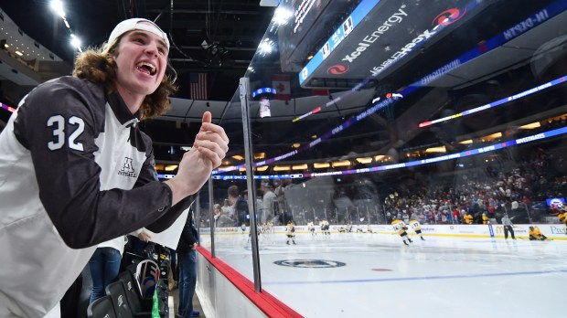 Mahtomedi senior Adam Olson taunts Mankato East/Loyola players as they warm up before a period of a Class A quarterfinal game in the State Boys' Hockey Tournament at Xcel Energy Center in St. Paul on Wednesday, March 7, 2018. (John Autey / Pioneer Press)