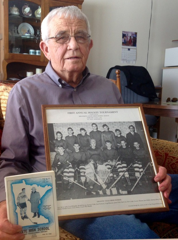 Gorman Velde, the last surviving member of the Granite Falls team that played in the first State Boys Hockey Tournament in 1945, holds some memorabilia, including a team photo of the 1944-45 team, at his Granite Falls home on Feb. 28, 2018 Velde, 90, was the goalie on the team, which lost in the first-round to eventual champion Eveleth. (Brian Murphy / Pioneer Press)