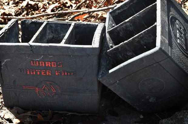 Wards and Delco battery containers that were found in retaining walls of Burnell and Sue Brown's house in White Bear Lake are seen on Wednesday, April 25, 2018. (Jean Pieri / Pioneer Press)
