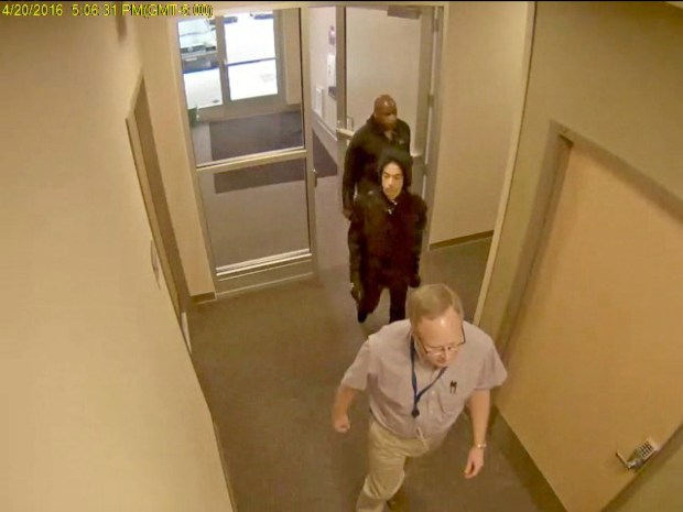 In this image made from surveillance video provided Thursday, April 19, 2018, by the Carver County Sheriff's Office, as part of an investigative file into Prince's death, the superstar, center, enters a clinic of Dr. Michael Todd Schulenberg on April 20, 2016, the day before he was found dead of an accidental fentanyl overdose. The doctor is not facing criminal charges and his attorney says he had no role in Prince's death. (Carver County Sheriff's Office via AP)