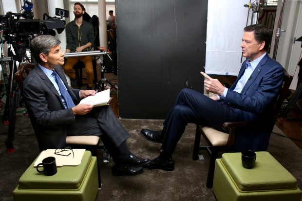 In this image released by ABC News, correspondent George Stephanopoulos, left, appears with former FBI director James Comey for a taped interview that will air during a primetime