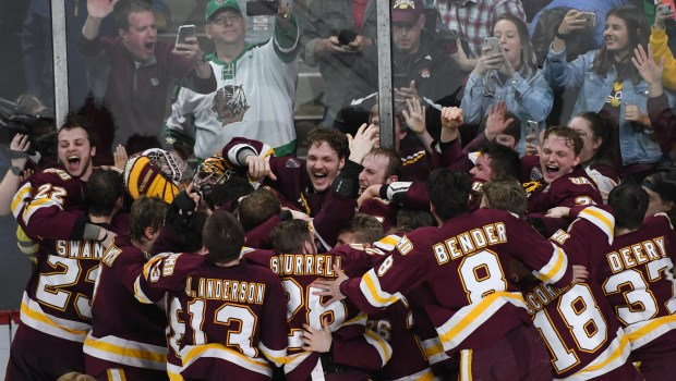 Minnesota-Duluth celebrate their 2-1 victory over Notre Dame in the Men's NCAA Frozen Four Championship game at Xcel Energy Center on Saturday, April 7, 2018. (John Autey / Pioneer Press)