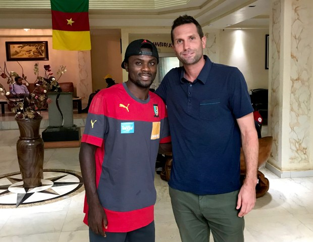 Minnesota United assistant coach and scout Ian Fuller, right, poses with new Cameroonian winger Frantz Pangop during his scouting trip to the African country in October 2017. (Courtesy of Ian Fuller)