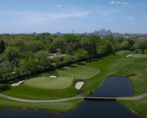 Aerial photo of the par-3 seventh hole at Midland Hills Country Club, with downtown Minneapolis in the background. This is one of Midland Hills' template holes, known as Eden -- a medium-length par 3 with a pot bunker front right and bunkers back right and front left. In Midland Hills' early years and in Seth Raynor's original design, this was the third hole. (Courtesy of Midland Hills Country Club)