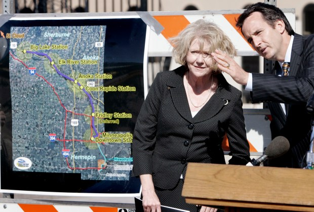 U.S. Transportation Secretary Mary Peters and Minnesota Gov. Tim Pawlenty get a close look from the bridge where the Northstar commuter rail line and the Hiawatha light-rail line will connect in Minneapolis as the early phase of construction is underway Tuesday, July 10, 2007. A map, left, shows the 40-mile Northstar line which will run from Minneapolis to Big Lake, Minn. (Jim Mone / Associated Press)