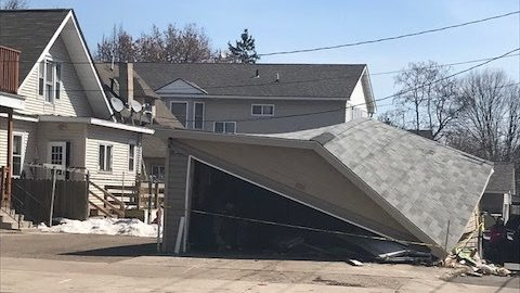 The photo shows a garage that was damaged in a crash that left one man dead late Friday, April 21, 2018. (Courtesy St. Paul Police Department)