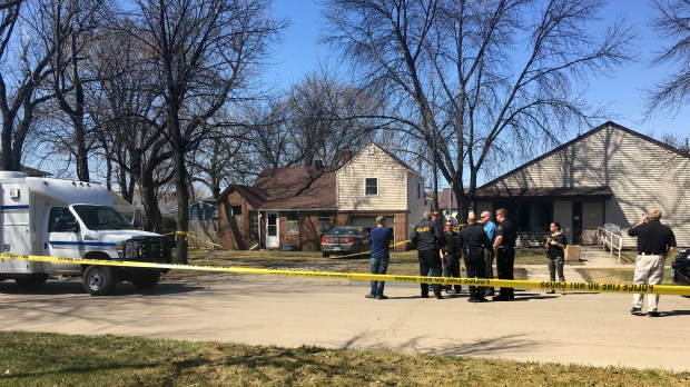 Authorities investigate the scene at a Grand Forks residence where four people were found dead on Thursday morning, May 3, 2018. School officials say they were a parent and three students in the school district, a school news release said. (Korrie Wenzel / Forum News Service)