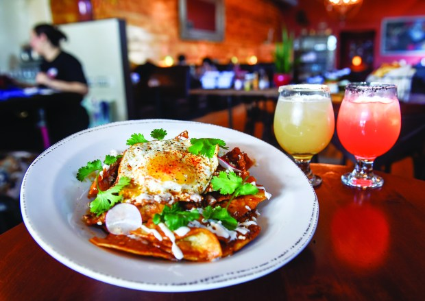 The new Pajarito offers craft cocktails, including a variety of margaritas, the Pineapple Express, left, and the seasonal Phenix along with Mexican food including this plate of Chilaquiles Thursday, February 22, 2018. (Special to the Pioneer Press: Craig Lassig)