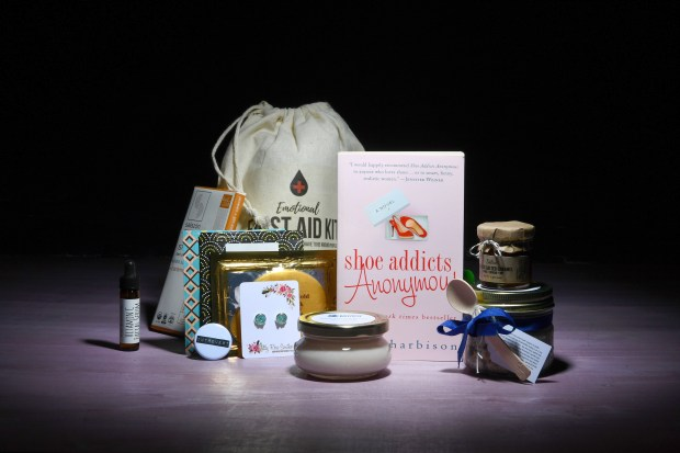 """The Introverts Retreat book-box subscription comes loaded with items to pamper, and in one sample box the novel """"Shoe Addicts Anonymous,"""" by Beth Harbison. (Katherine Frey / Washington Post)"""