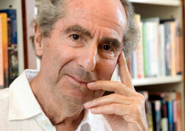 In this Sept. 8, 2008, photo, author Philip Roth poses for a photo in the offices of his publisher, Houghton Mifflin, in New York. (AP Photo/Richard Drew)