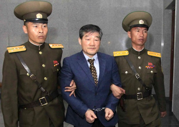 In this April 29, 2016, photo, Kim Dong Chul, center, a U.S. citizen detained in North Korea, is escorted to his trial in Pyongyang, North Korea. U.S. Secretary of State Mike Pompeo has left North Korea with three American detainees, one of them Kim Dong Chul, who were released ahead of an upcoming meeting between President Donald Trump and North Korean leader Kim Jong Un, the U.S. president said in a tweet Wednesday.(AP Photo/Kim Kwang Hyon)