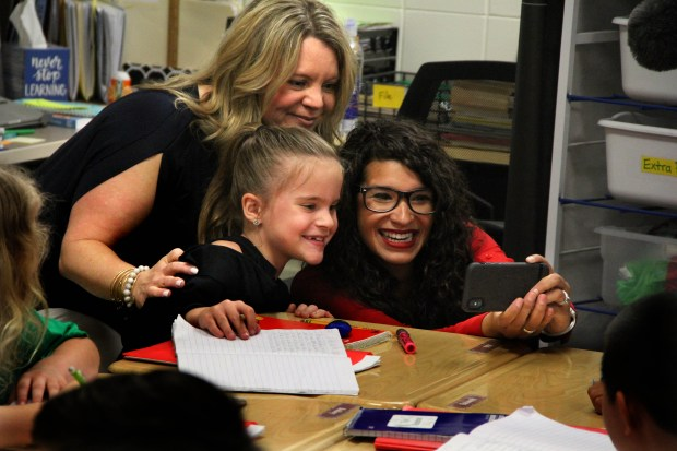 Rep. Erin Maye Quade, DFL-Apple Valley, takes a selfie with fifth-grader Abi Harris and her mom Maria Wednesday, May 9, 2018 at Parkview Elementary School in Lakeville. Maye Quade joined Democratic Gov. Mark Dayton on a visit to the Rosemount-Apple Valley-Eagan school district to support his request for $138 million in emergency school aid to help districts across the state avoid budget cuts. (Christopher Magan / Pioneer Press)
