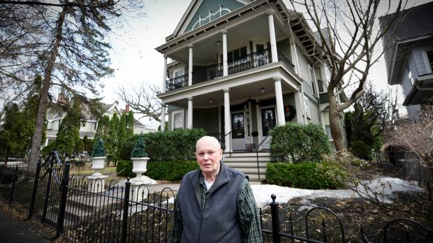 Ray Meyer stands in front of his meticulously restored 1890s-era Queen Anne Victorian home on Monday, April 23, 2018. (John Autey / Pioneer Press)