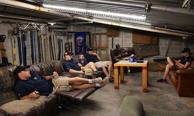 Members of the Target Field grounds crew relax in their lair under the 1st base side stands in the seventh inning of the Minnesota vs Milwaukee MLB baseball game at Target Field on Friday May 18, 2018. The space contains all the tools and materials for maintain of the field along with old couches and a tv. (John Autey / Pioneer Press)