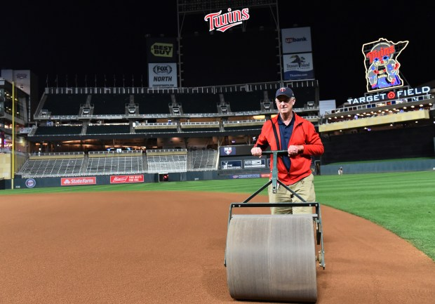 Target Field head grounds keeper Larry DeVito uses a heavy roller to compress the infield after the Minnesota game against Milwaukee at Target Field on Friday May 18, 2018. (John Autey / Pioneer Press)