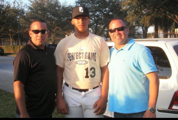 (l-r) Trainer Felix Taveras, 16-year-old Fernando Romero and former Twins scout Hector Otero in Jupiter,  Fla., on the day Romero signed his first pro contract in October. 2011.