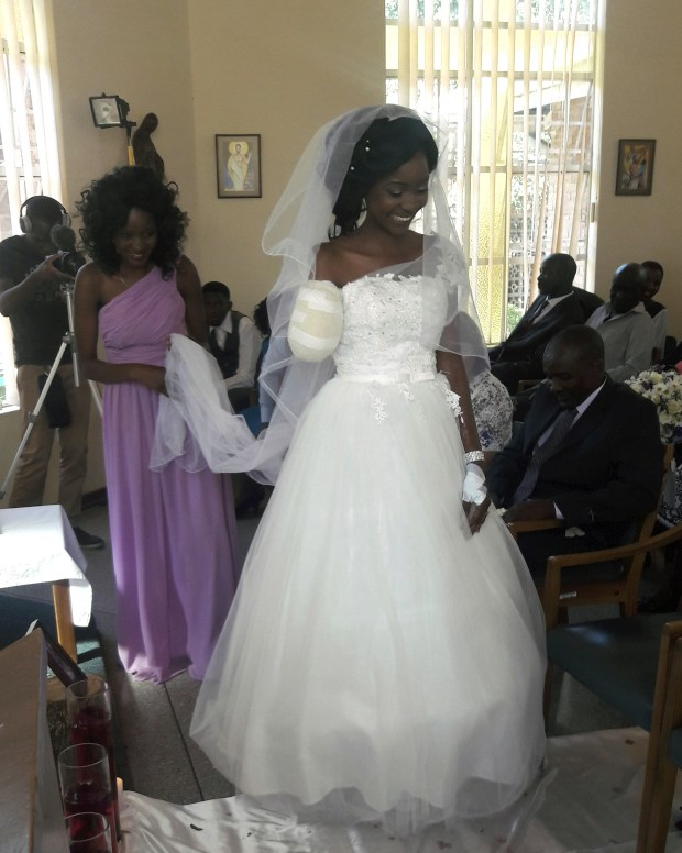 Zanele Ndlovu walks down the aisle on her wedding day, Saturday, May, 5, 2018, at a hospital Chapel in Bulawayo, Zimbabwe, days after she and her fiance were attacked by a crocodile. (AP Photo)