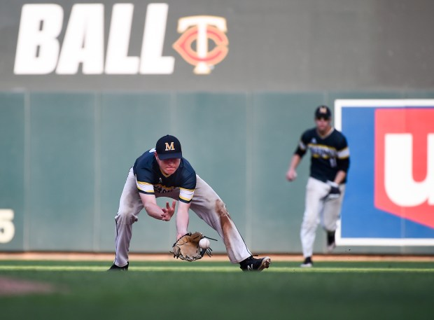 Maple Lake's second baseman Tyler Johnson picks up a ground ball hit by Marshall School's Ben Clapp and makes the throw to first for an out in the seventh inning of their 2A State Baseball Tournament championship game at Target Field in Minneapolis, Saturday June 16, 2018. (Special to the Pioneer Press: Craig Lassig)