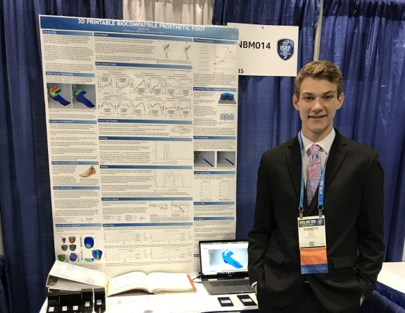 Stillwater student Everett Kroll stands in front of his first-place project, the creation of an affordable and durable 3-D-printed prosthetic foot, at the 2018 International Science and Engineering Fair May 17, 2018. (Courtesy of Everett Kroll)