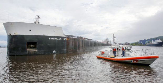 The U.S. Coast Guard checks American Spirit for leaks on Sunday after the ship ran aground in the harbor. (Tyler Schank / Duluth News Tribune)
