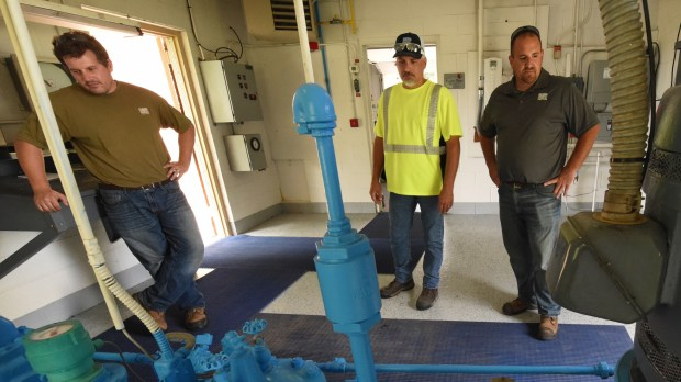 "St. Paul Parks maintenance workers Tony Brinkman, left, Tony Flandrich and public works supervisor Jeff Dionisopoulos at well house 3 on Lincoln Avenue in St. Paul Park on Thursday, June 28, 2018. It was shut down in May 2017. Pictured is the well pump, right, and valves and piping. ""Every day we're here to check and read the meters,"" said Dionisopoulos. (Jean Pieri / Pioneer Press)"
