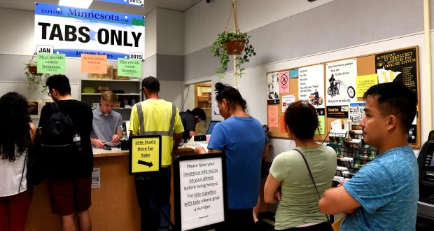 People wait in line for tabs at a deputy registrar's office inside the Sears store on Rice St. in St. Paul on Wednesday, June 27, 2018. The computer system for vehicle title and tabs, known as MNLARS, has been beset by problems since it was first launched in July 2017. (Jean Pieri / Pioneer Press)