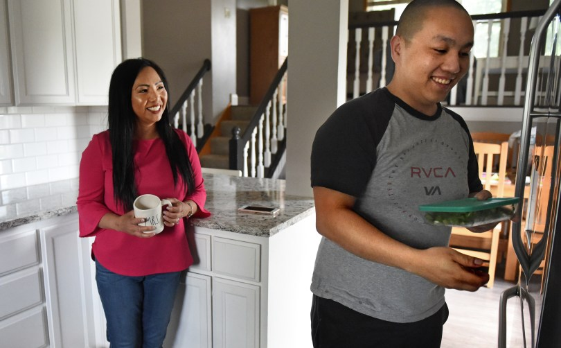 Kellie Chauvin from Oakdale talks with her son, George Xiong, who grabs soup from the refrigerator for lunch before going to work on Friday, June 1, 2018. Chauvin, 43, is vying to be the first Hmong Mrs. Minnesota America. (Jean Pieri / Pioneer Press)