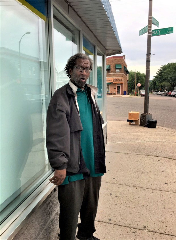 Leeland Bourrage, 68, stands in front of the undamaged facade of Joseph's Coat in St. Paul Monday, June 11, 2018. The store, which provides free clothes and other items to the working poor and homeless, was extensively damaged June 7 when a vehicle plowed through the building. The driver sped away and has not been located. The store remains closed for at least six more weeks. (Ruben Rosario / Pioneer Press)