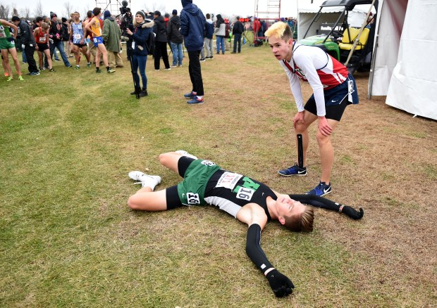 789dc3b4b5c Austin Streit of Mounds View rests at the finish line after the boys Class  AA race. (Sherri LaRose-Chiglo   For the Pioneer Press)