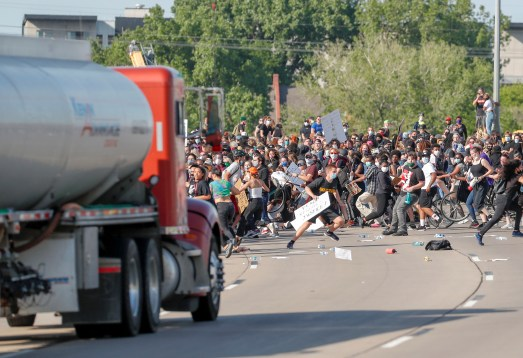 Truck drives through crowd in Minneapolis, apparently hitting none; evening  sees mass arrests but little violence – Twin Cities
