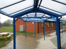 The walkway connects the main school building to an outside classroom.