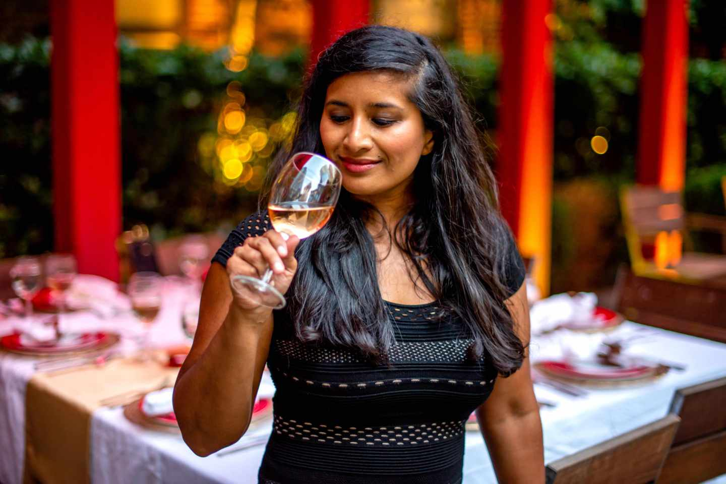 Woman Sipping Monis Cellars Rose. Fall Dinner Party Ideas.
