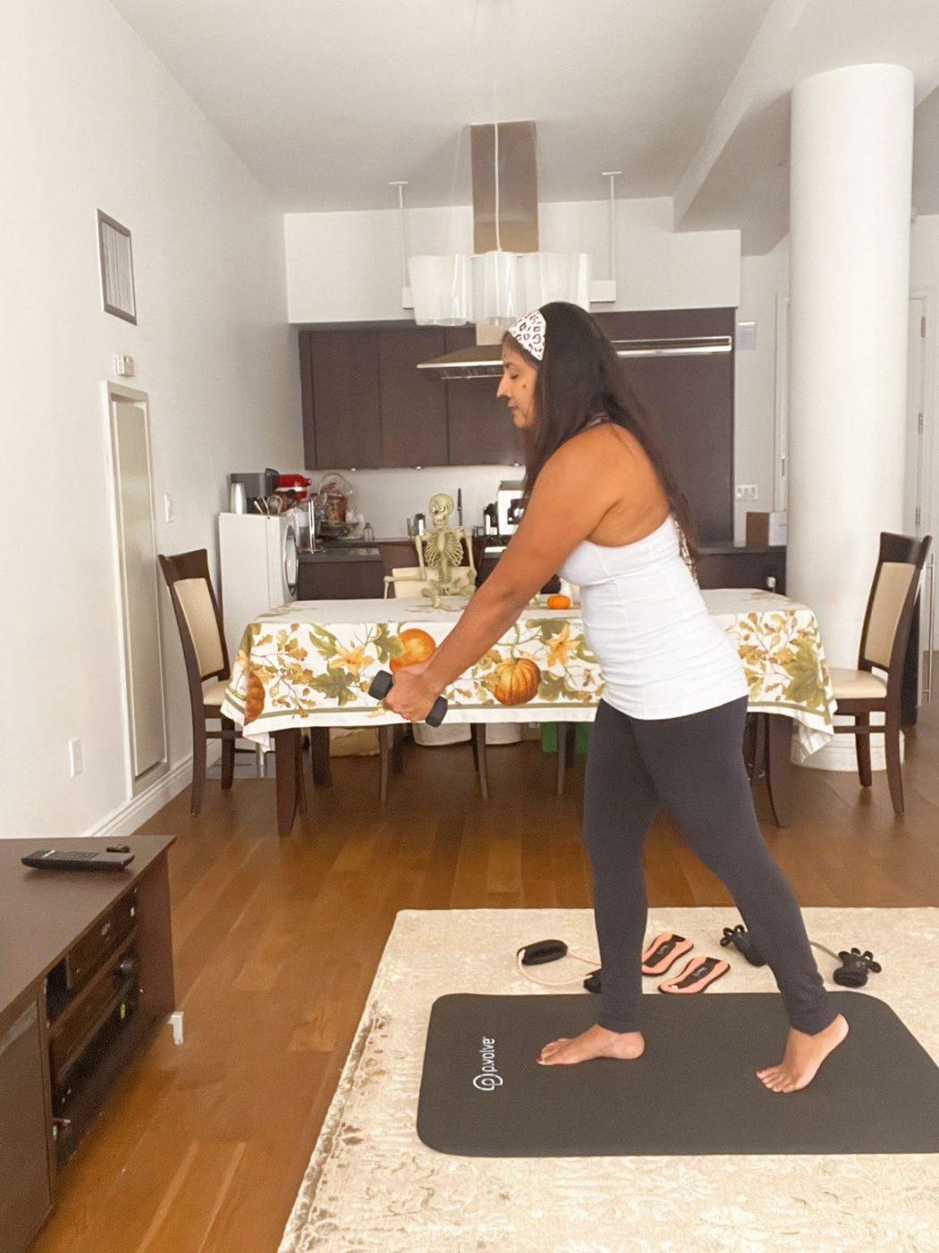 best workouts at home: P.volve. Halloween workout ideas. Light dumbbells.