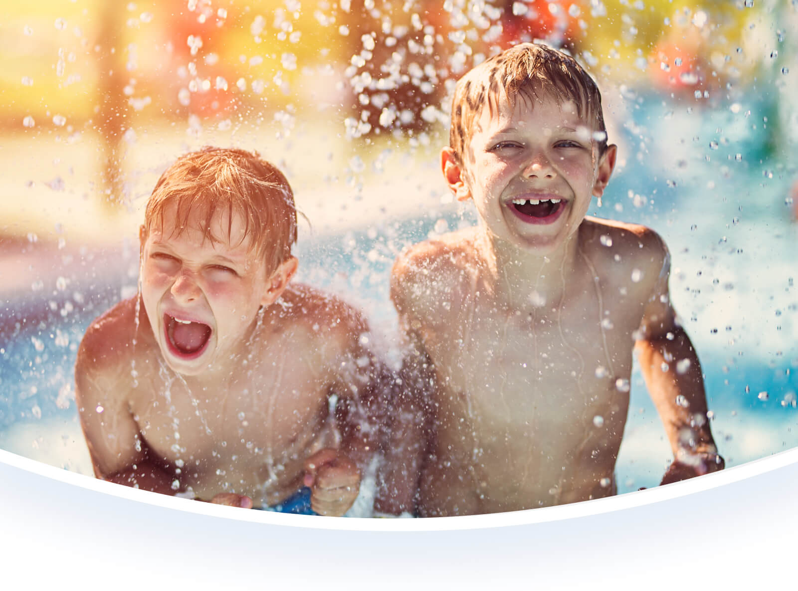 Two boys playing in water.