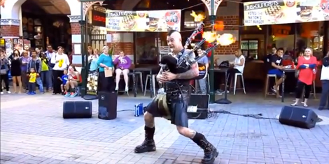 "The Badpiper with his flaming bagpipes during a performance of ""Plunderstruck"" a cover of AC/DC's ""Thunderstruck"""