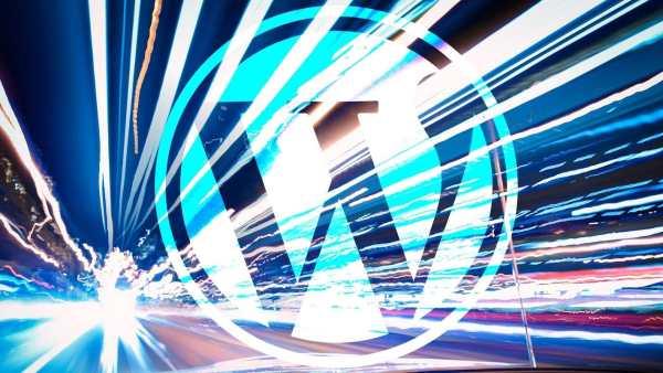 WordPress logo on blurry road.