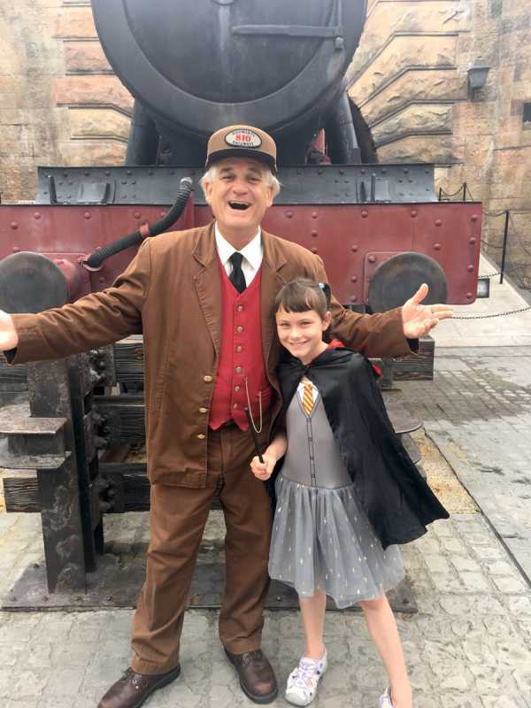 My daughter with the conductor posing for a picture