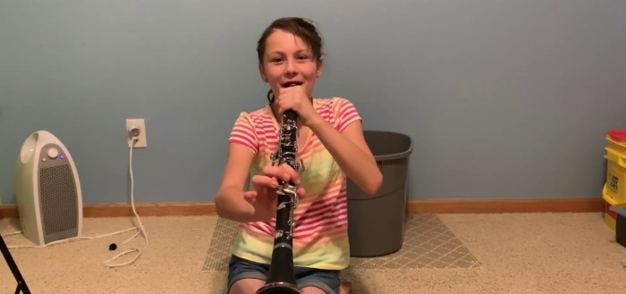 Lily playing clarinet.