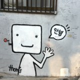 Wall art of robot guy saying hi
